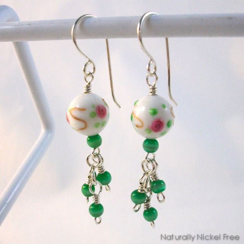 White Glass Bead Earrings Rose Design with Green Bead Tassel - product image