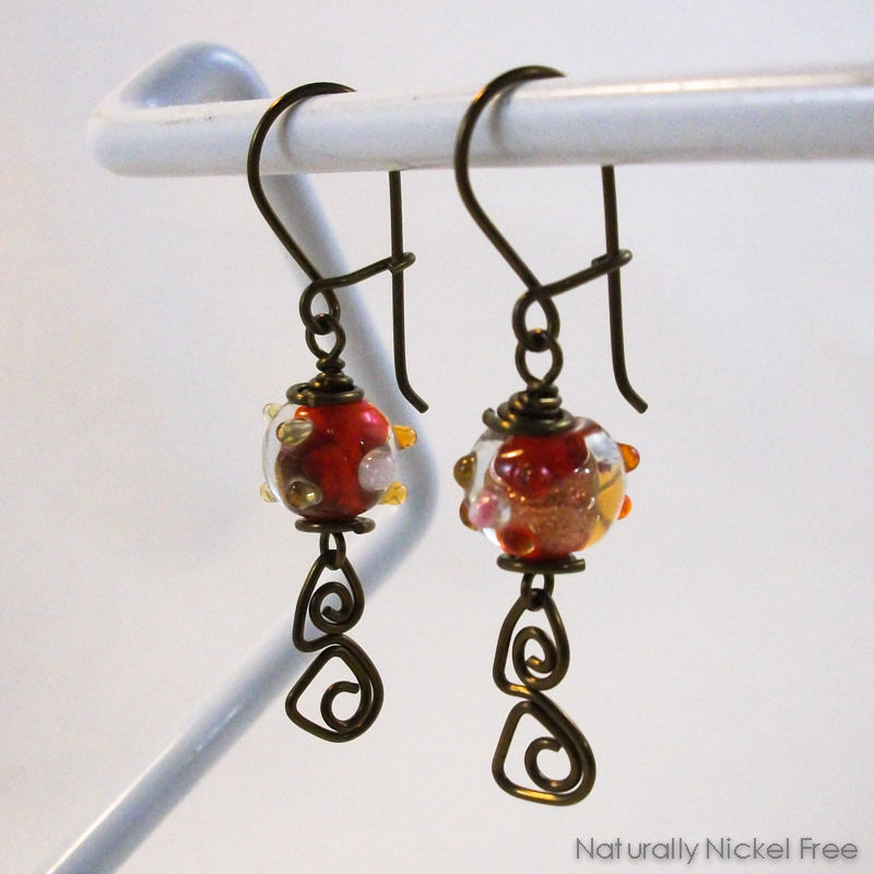 Red Glass Earrings with Niobium Abstract Wirework - product images  of