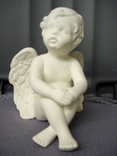 Gazing Cherub with Hands over Knees - product images