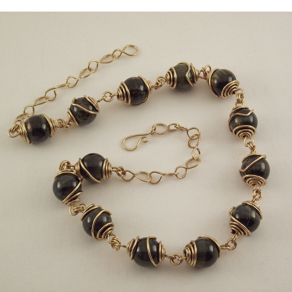 blue tiger eye gemstone wire caged bead necklace and