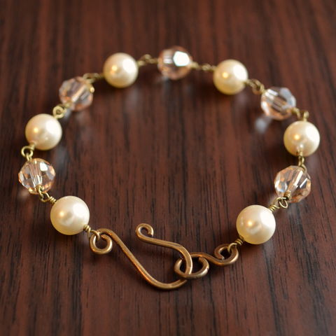 Crystal,and,Ivory,Pearl,Bracelet,in,Antiqued,Brass,jewelry, bracelet, bridal, wedding, antiqued brass, bronze, swarovski, pearl, crystal, golden shadow, ivory