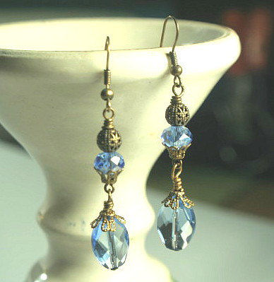 Vintage,Victorian,elegance,-,Earrings,in,Lt,Sapphire,,Faceted,Ovals,accented,by,filigree,bead,caps.,Jewelry,Dangle,dangle_earrings,wedding,earrings,Crystal,Romantic,Vintage_Gold,Victorian_Style,Old_world,Lt_Sapphire,Quartz_Glass,Brass,Bronze,Hand Faceted Quartz Glass