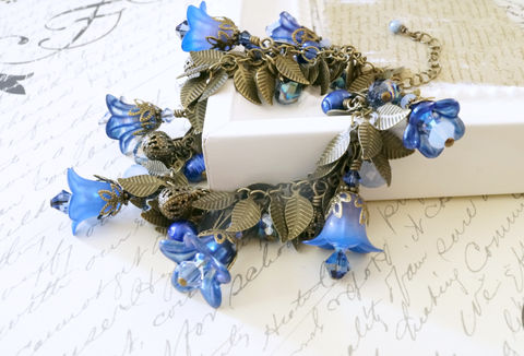 Airbrushed,and,Enameled,Lucite,Flower,Charm,Bracelet,lucite flower bracelet, lucite flower charm bracelet, charm bracelet, brass bracelet, dangle bracelet, handmade bracelet, blue bracelet, blue flowers, hand dyed Lucite flowers, enameled Lucite flowers handmade jewelry, fresh water pearls, Sahetah's jewelr