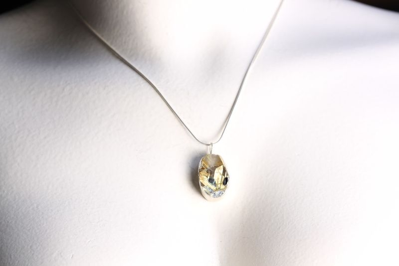 Rutilated Quartz Pendant with Hematite Inclusions - product images  of