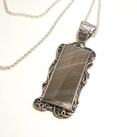 Mirror,|,silver,&,striped,flint,pendant,Striped flint pendant, hammered silver pendant, handmade jewellery store London