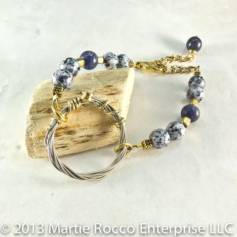 Guitar,String,bracelet,with,blue,mottled,glass,and,brass,beads