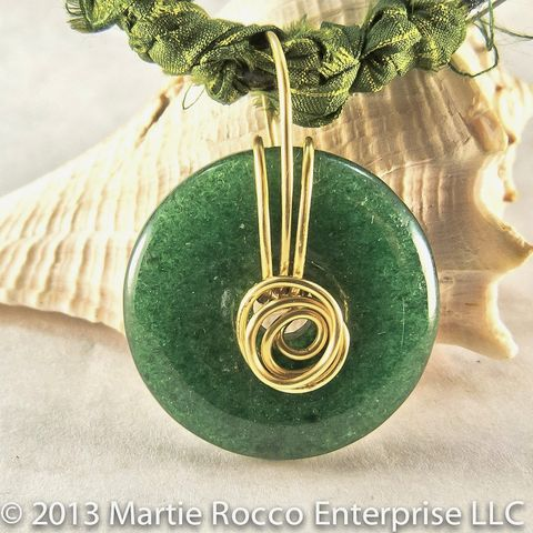 Green,goldstone,donut,wire,wrapped,pendant,with,silk,and,leather