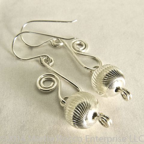 Sterling,silver,earrings,with,diamond,cut,bead,and,scroll,wire,Sterling silver earrings with diamond cut bead and scroll wire