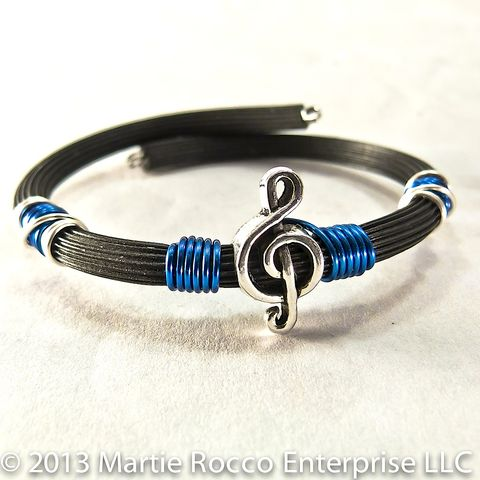 Pewter,Treble,clef,bracelet,blue,wire,wrap,rubber,tube,memory,Pewter Treble clef bracelet blue wire wrap rubber tube memory wire