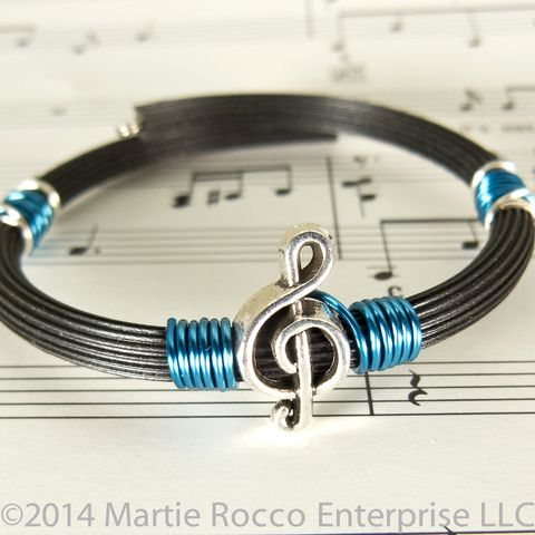 Pewter,Treble,clef,bracelet,teal,blue,wire,wrap,rubber,tube,memory,Pewter Treble clef bracelet teal blue wire wrap rubber tube memory wire