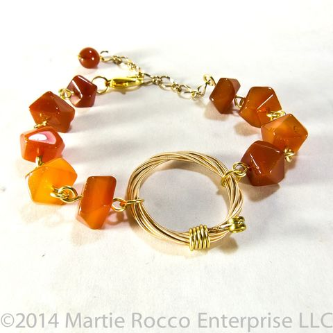 Guitar,String,bracelet,orange,carnelian,faceted,chunks.,Guitar String bracelet orange carnelian faceted chunks.