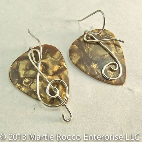 Brown,Pearl,Guitar,Pick,earrings,with,wire,treble,clef,and,music,note,Guitar Pick earrings with wire Treble clef and music note. Brass, silver plate, Sterling Silver