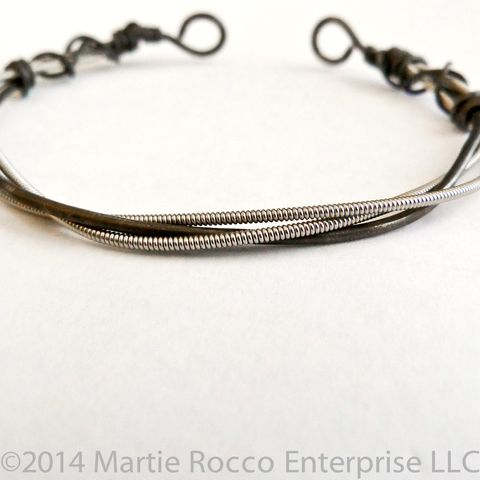 Guitar,String,open,bangle,black,annealed,steel,wire.,Guitar String open bangle black annealed steel wire.