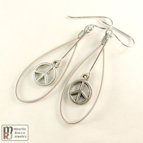 Marquise,shaped,Guitar,String,earrings,with,pewter,peace,sign,Marquise shaped Guitar String earrings with pewter peace sign