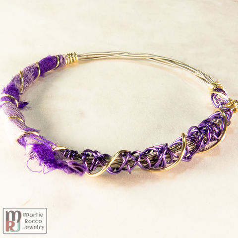 Guitar,string,bangle,bracelet,with,purple,floral,silk,and,wire,wrap,Guitar string bangle bracelet with purple floral silk and wire wrap