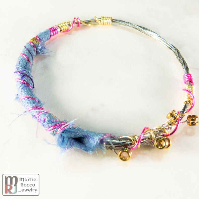 Guitar string bangle bracelet with blue floral silk and wire wrap ...