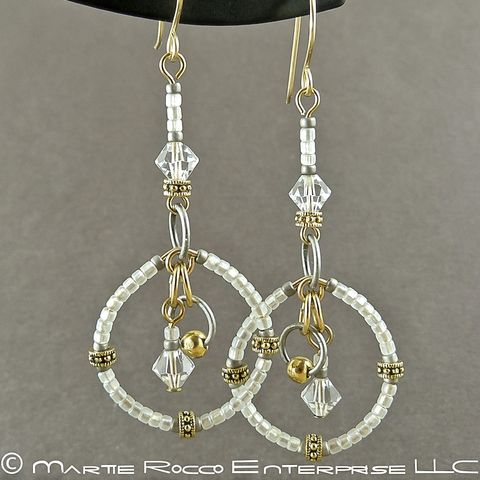 Long,white,round,hoop,earrings,in,seed,beads,and,crystals.