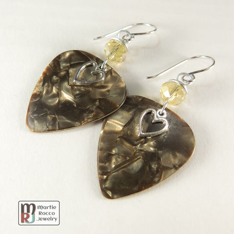 Brown,Pearl,Guitar,Pick,dangle,earrings,with,faceted,glass,Brown Pearl Guitar Pick dangle earrings with faceted bead and a pewter heart charm.