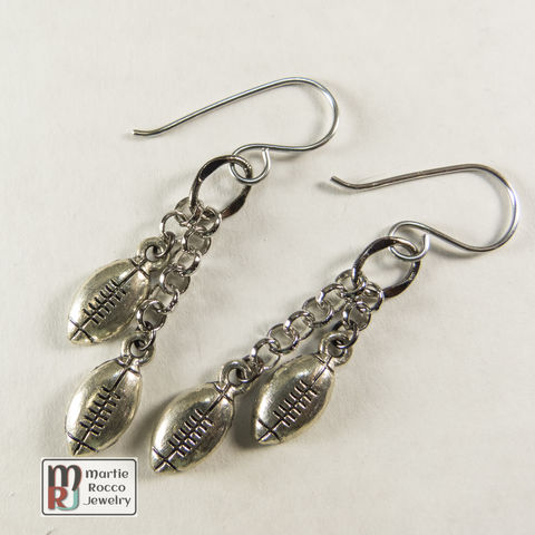 Pewter,football,charm,dangle,earrings,Dangle earrings with two cascading silver pewter plated football charms.