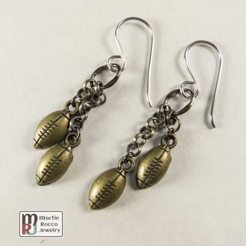Antique,Gold,football,charm,dangle,earrings,Dangle earrings with two cascading antique gold plated football charms.