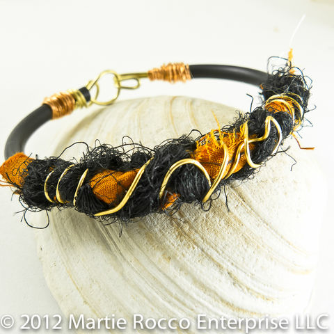 Orange,and,black,Silk,yarn,wrapped,bangle,bracelet,with,gold,copper,wire