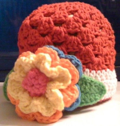 Crocheted,Red,Hat,with,White,Stripe,and,Flower,Crochet,Beanie,red,white,flower,photo_prop,green,yellow,blue,orange,children,shell_stitch,girl,acrylic_yarn