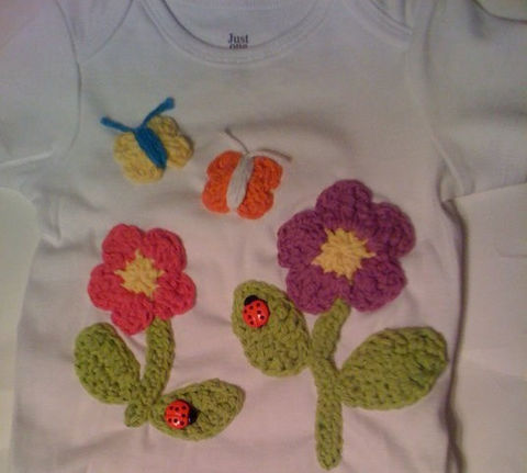 Shirt,with,crocheted,flowers,and,butterflies,clothing,shirt,tshirt,onesie,lady_bugs,infant,children,kids,pink,purple,green,acrylic_yarn,thread,shirt_or_onesie,lady_bug_center_piece