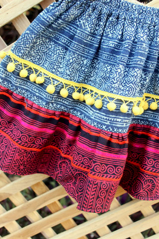 Briana,Little,Girls,Ethnic,Hmong,Skirt,Cranberry,and,Indigo,Batik,With,Bright,Yellow,Pom,Poms,Children,Clothing,bohemian_child,eco_friendly_clothes,Hmong_indigo_batik,hippie_chic,hippie_kids,ethnic_clothes,boho,girls_clothes,fair_trade,colorful_skirt,batik,3_4_5,red,natural cotton,indigo batik cotton,appliqued cotton,pom poms