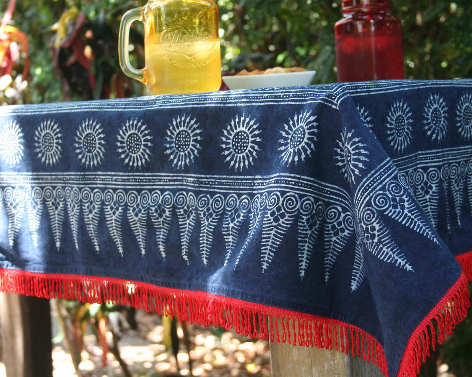 Indigo batik picnic throw or tablecloth with red trim