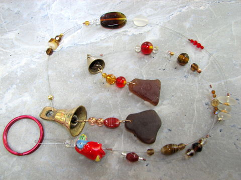 Beaded,Seaglass,Wind,Chime,with,Parrot,in,Brown,and,Reds,ocean decor, ocean windchime, beaded, bead, sea glass, seaglass, Hawaii, wind chime, windchime, sun catcher, suncatcher, beach, ocean, nautical, parrot, bits off the beach, home decor, decoration, porch, deck, yard art, red, brown,