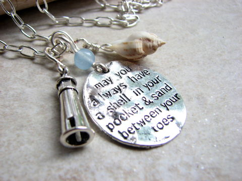 Long,Coastal,Necklace,with,Beach,Quote,,Lighthouse,and,Shell,Charms,beach necklace, coastal jewelry, lighthouse necklace, blue quartzite, natural shell pendant, shell in your pocket, sand between your toes, 30 inch chain, beach quote pendant, ocean quote, hand made, bits off the beach, lighthouse jewelry, light house, sea