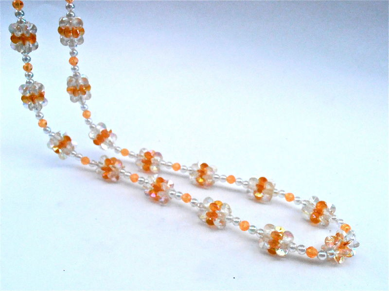 Vintage Orange Peach Flower Clusters Bead Necklace Single Strand Aurora Borealis Light Amber Plastic Iridescent Lei Floral Costume Jewelry  - product images  of