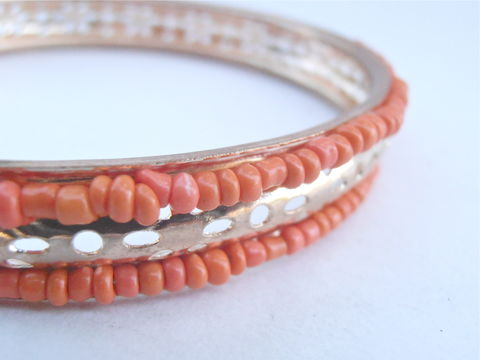 Vintage,Faux,Coral,Gold,Tone,Bracelet,Tiny,Seed,Peach,Beads,Bangle,Stackable,Orange,Petals,Pin,Holes,8.25,Inches,Tangelo,Tangerine,vintage faux coral seed bead bangle, vintage 8 25 inch gold tone bracelet, vintage coral seed 8 25 inch bangle, vintage tangelo peach bangle, tangerine bead bracelet, vintage boho orange bracelet, vintage gold tone stackable bracelet, gold petal bracelet