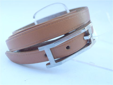 Hermes,Hapi,Calf,Wrap,Leather,Tan,Bracelet,Pre,Owned,hermes hapi calf tan wrap leather bracelet, pre owned hermes leather bracelet, wrap around leather bracelet, hermes H logo silver buckle, leather strap, used hermes hapi brown bracelet, designer leather bracelet, signature leather bracelet