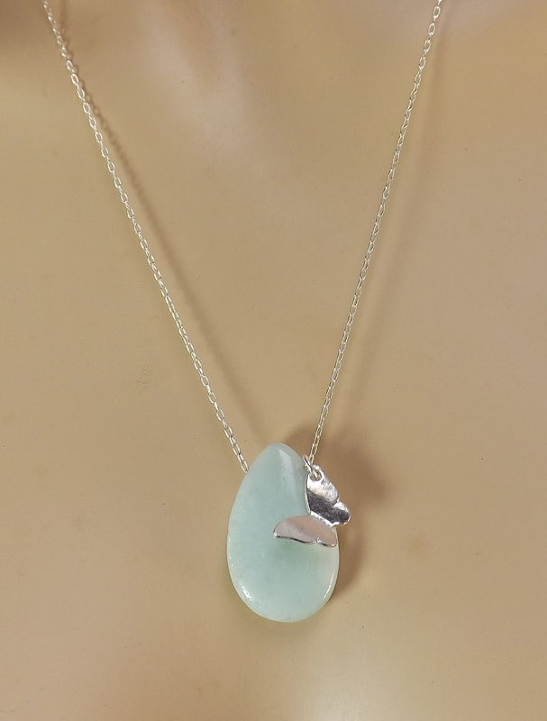 Silver plated accents . Fashion necklace with Amazonite pendant