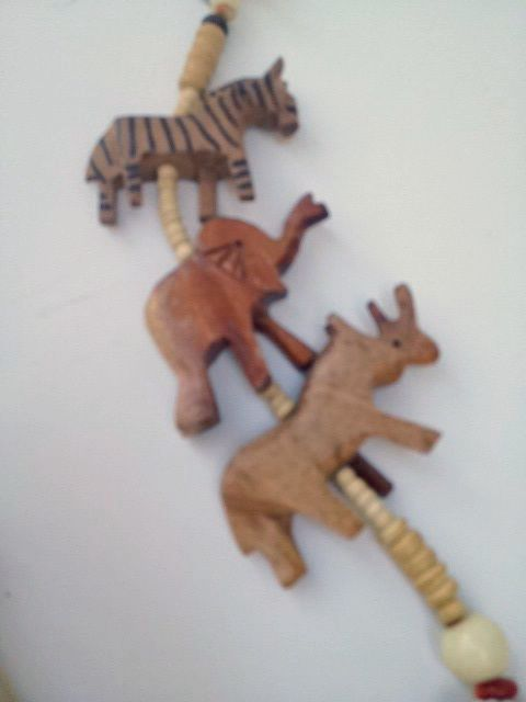 Ethnic wood and shell beaded necklace jungle animals for Classic jungle house for small animals