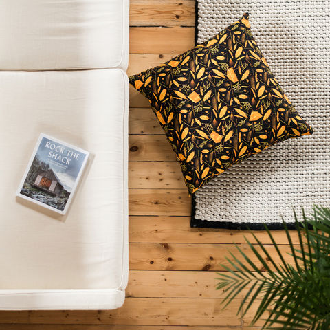 Nest,Building,Materials,Orange/Black,Giant,Floor,Cushion,cushions, cushion, large cushion, pillow, pillows, design, home decor, decor, furnishings, nest, nest building, feathers, leaves, orange, mid century, patterned, pattern, black, cabins, cabin, aframe, nature, fir, trees, floor cushion, giant floor cushion