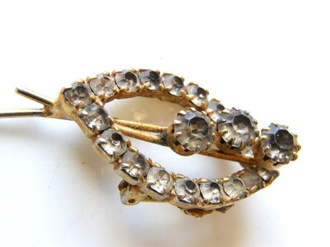 Vintage,Rhinestone,Brooch,with,Abstract,Open,Oval,Fish,Design,Jewelry,classic,oval_design,fish_like,prong_set,crystal,rhinestones,metal_bars,metal_base,rhinestone_brooch,vintage_brooch,smoke_rhinestones,metal