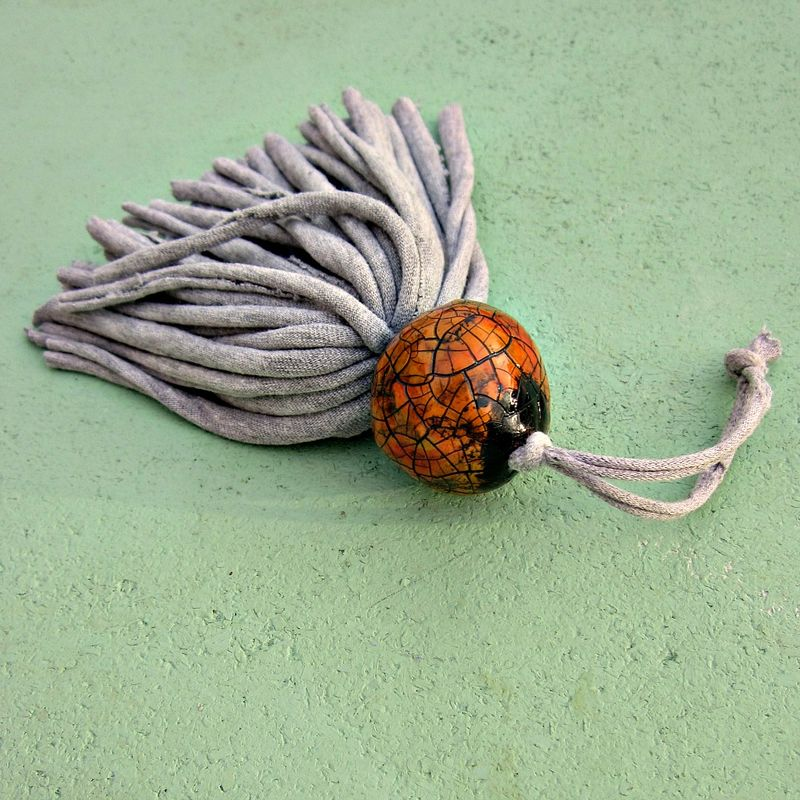 Salvaged Light Gray Fiber Tassel with Big Orange Crackled Paper Mache Bead: Mortimer - product images  of