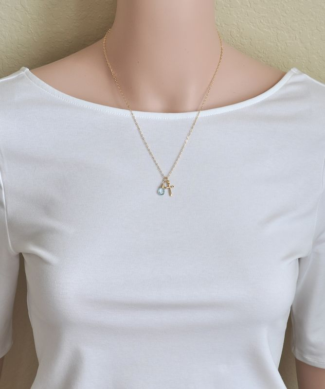 Small Gold Filled Cross Necklace with Birthstone for December - product image