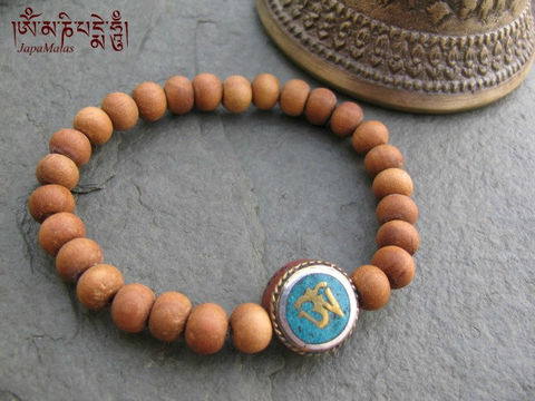 Sandalwood,Bracelet,Mala,with,Om,guru,bead,purified,&,blessed,mala,Jewelry,Beadwork,sandalwood,japa_mala_bead,hindu,buddhist_mala,meditation,yoga,zen,prayer_beads,worry_beads,yoga_jewelry,bracelet,reiki,sandal wood beads,mantras,pure intention,elastic cord,om bead