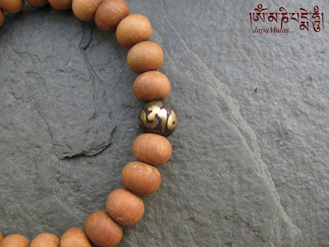 Sandalwood,Bracelet,Mala,with,Mantra,guru,bead,purified,&,blessed,mala,Jewelry,Beadwork,sandalwood,japa_mala_bead,hindu,buddhist_mala,meditation,yoga,zen,prayer_beads,worry_beads,yoga_jewelry,bracelet,christmas_in_july,sandal wood beads,mantras,pure intention,elastic cord,om bead