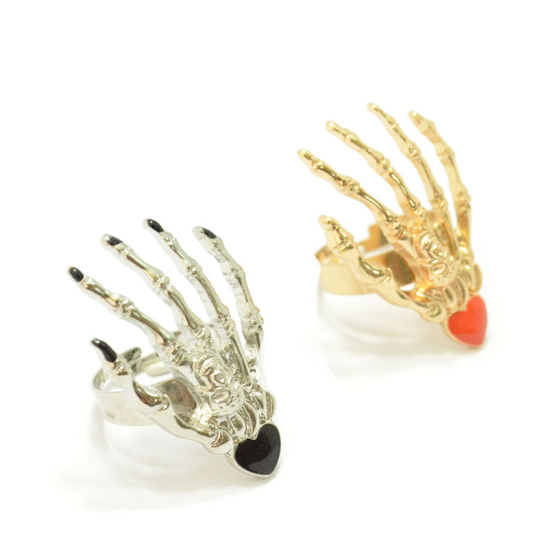 SKELETON HAND WITH SHINY HEART RING - product image
