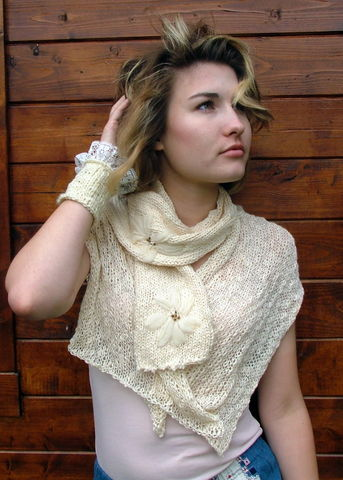 Knitted,capelet,and,scarf,with,hand,embroidered,motif,cardigan,coat,knitwear