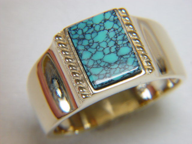 natural spiderweb turquoise set in heavy 14 karat gold ring product images of