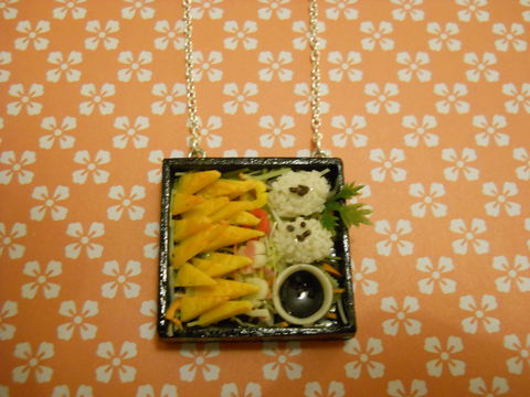 Sushi,Bento,Box,Necklace,6,Kitsch wooden Bento Box pendant filled with miniature kawaii onigiri and egg sushi on a silver necklace. pendant filled with silver glitter  and backed with silver glitter. The pendant also features a dog with cherries and a cake