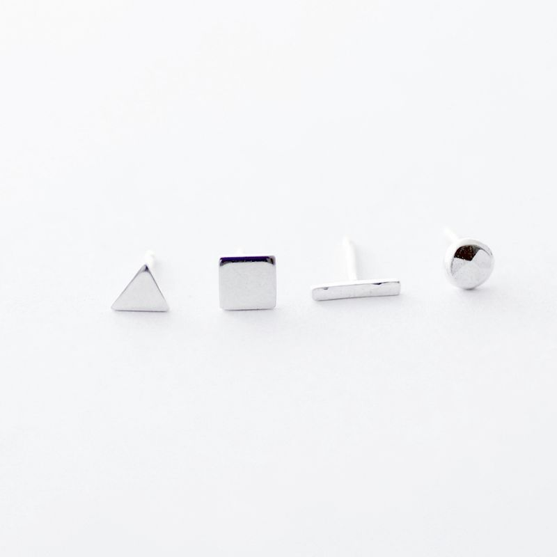 Tiny geometric silver mismatched stud earrings - product images  of