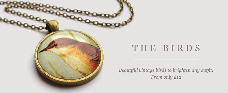 Beautiful handmade brass necklace by Ruby Spirit Designs with vintage bird picture pendant