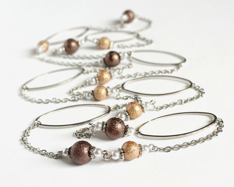 Silver,hoop,and,textured,brown,beads,extra,long,necklace,/,double,very long necklace, extra long necklace, double necklace, 2 way necklace, silver oval hoop necklace, long silver necklace, silver brown necklace, brown beaded necklace