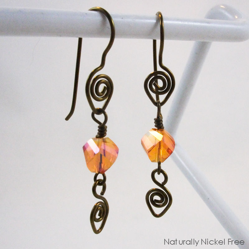 Amber Glass Spiral Niobium Dangle Earrings - product image